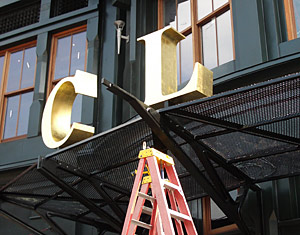 Installing Signage at Clyde's Restaurant