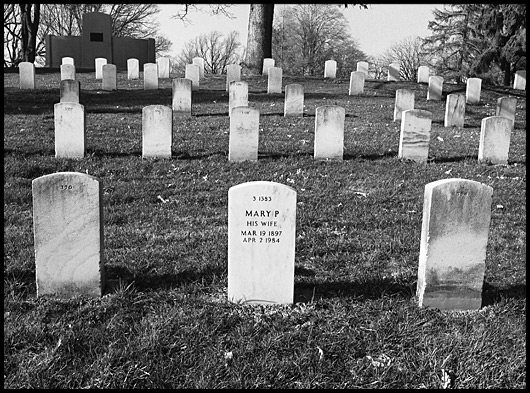 Tombstones with one stating: Mary P, His Wife