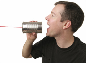 speaking into a tin can telephone